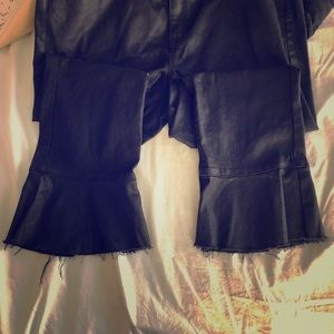 Edgy black treated jeans with flair!!
